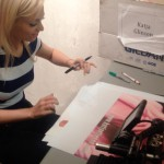 Katja Signs Posters for Special Agents
